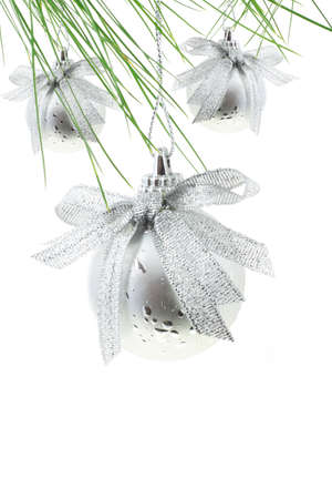 pine three: Silver Christmas tree baubles on white background Stock Photo