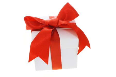 giftbox: Gift box with red bow ribbon on white background Stock Photo