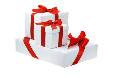 three presents: Three white gift boxes with red bow ribbons
