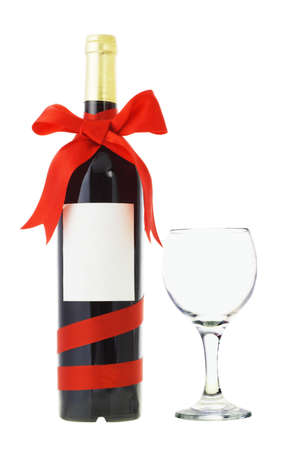 Bottle of wine decorated with red bow ribbon and glass on white photo
