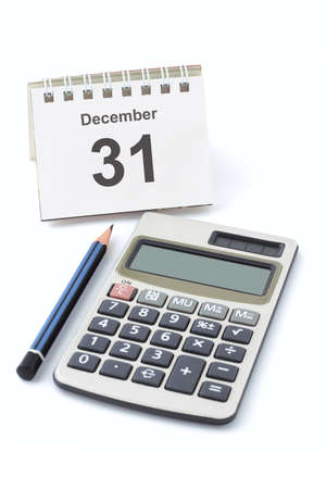 Calendar showing new year eve, electronic calculator and pencil  Stock Photo - 10457417