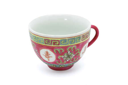 teacup: Chinese red tea cup on white background