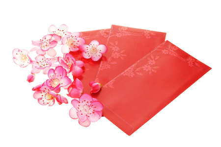 backgound: Chinese plum blossoms and red packets on white backgound Stock Photo