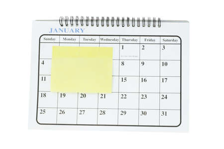 Blank adhesive note paper on January page of desktop to fill in resolutions and to do list photo