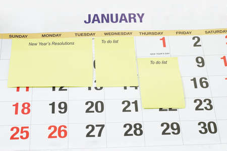 Blank yellow adhesive note papers sticking on calendar page to fill in new year's resolutions and to do lists Stock Photo - 10457500