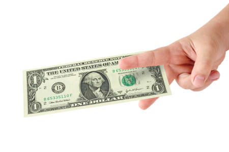 cost reduction: Childs fingers showing cutting sign on US one dollar bill