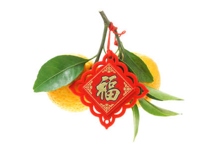 mandarin oranges: Mandarin oranges decorated with red Chinese new year ornament