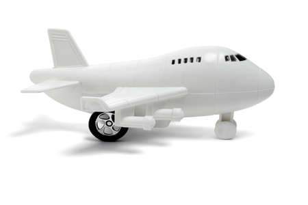 Plastic toy passenger jet plane on white background Stock Photo