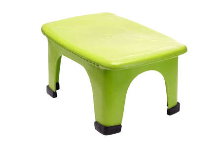 Small green plastic stool on white background photo