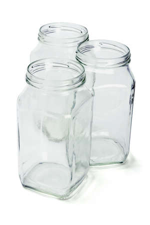 Three open empty glass containers on white background