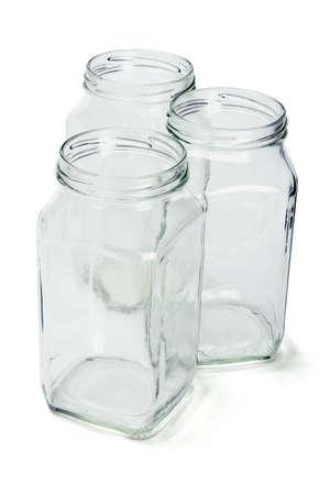 reciclar vidrio: Tres recipientes abiertos vaso vac�o en el fondo blanco Foto de archivo