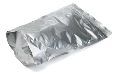 Sealed aluminum foil bag containing cereal on white background photo