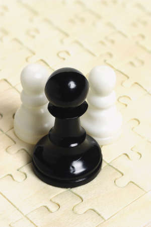 jig: Black and white chess pawns on jig saw puzzle background