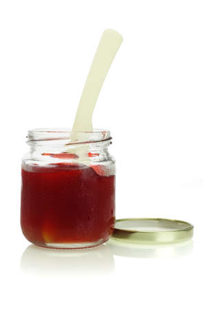 open cold and moist jar of mixed fruit jam on white background photo