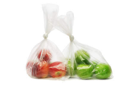 plastic container: Two plastic bags of red and green apples on white background