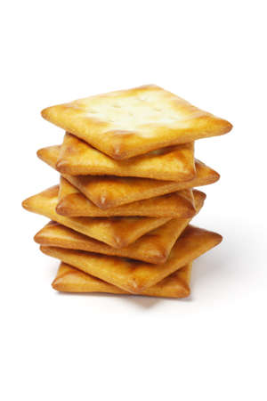 Stack of square shape crackers on white background photo
