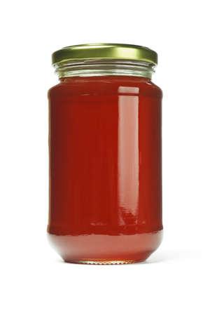 Fresh honey in glass jar on white background