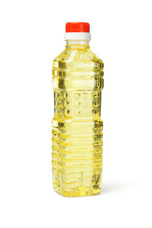 Plastic bottle of vegetable cooking oil on white background photo