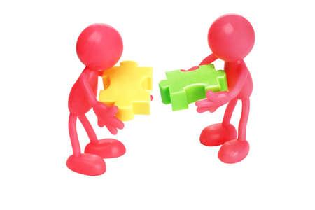matching: Faceless figurines matching jigsaw puzzle blocks on white background