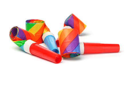 Close up of colorful party blowers on white background