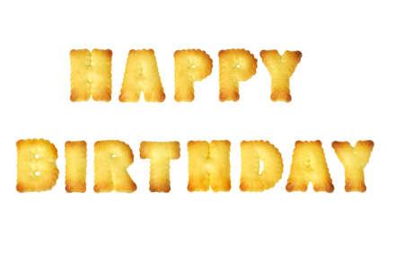 Happy Birthday alphabet cookies arranged on white background photo
