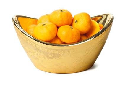 mandarin oranges: Mandarin oranges in gold ingot container on white background