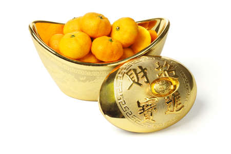 Mandarin oranges in gold ingot container on white background