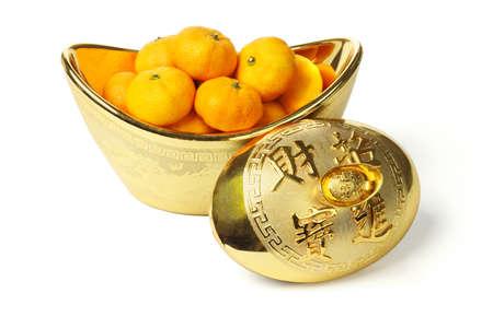 Mandarin oranges in gold ingot container on white background photo