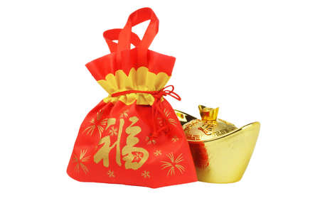 Chinese New Year Gift Bag and Gold inpgot Ornament on White Background Stock Photo - 11971402