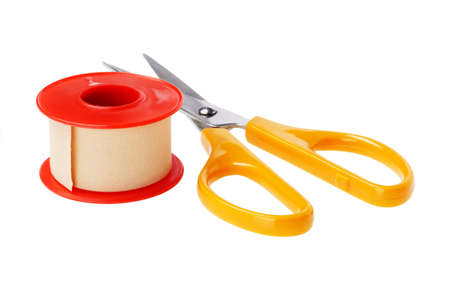 Roll of Medical Sticking Plaster and cutting scissors on White Background photo