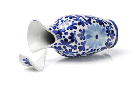 Broken Porcelain Vase Lying on White Background photo