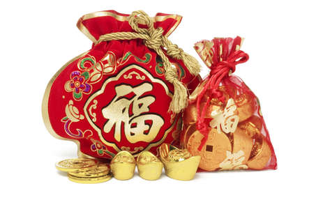 gold string: Two Chinese New Year Gift Bags and Gold Ingots on White Background Stock Photo