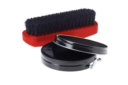 flat brush: Open Container of Shoe Polish and Brush on White Background