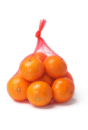 Fresh Oranges in Plastic Mesh Sack on White Background photo