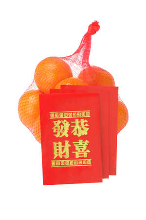 Chinese New Year Red Packets and Oranges on White Background photo
