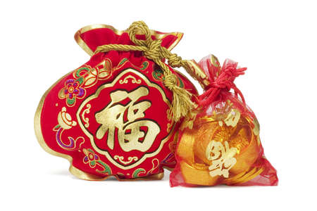 Two Chinese New Year Gift Bags and Gold Ingots on White Background Stock Photo - 15142378