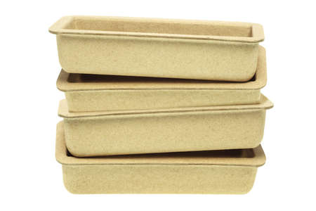 Stack of Recycled Paper Trays on White Background photo