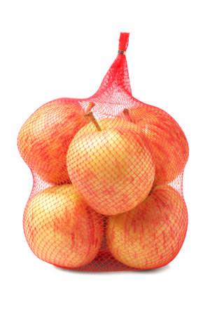 Apples in Kunststoffnetz Sack auf weißem Hintergrund Standard-Bild