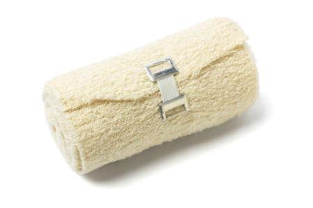 gauze: Roll of Elastic Crepe Bandage Lying on White Background