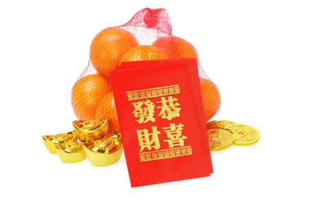 Chinese New Year Ornaments and Oranges on White Background photo