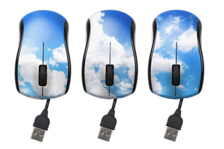 superimposed: Blue Sky With Clouds Superimposed on Computer Mouse