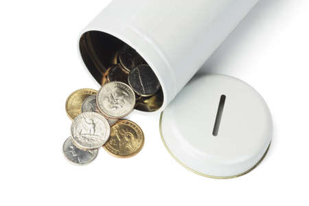cash box: Coins Spilled Out From Open Tin Can on White Background Stock Photo