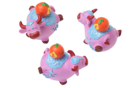 Ox Figurines Chinese New Year Ornaments on White Background Stock Photo - 17072851
