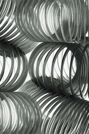 slinky: Black Slinkies on White Background