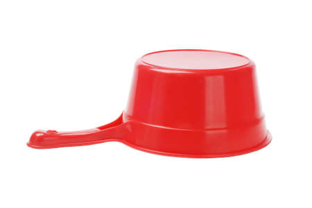Inverted Red Plastic Scoop On White Background photo