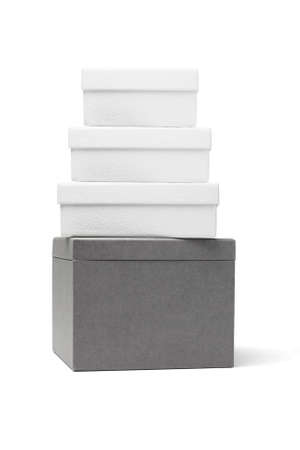 Stack Of Cardboard Gift Boxes On White Background photo