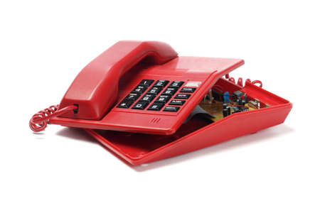Red Telephone Exposing Internal Components On White Background photo