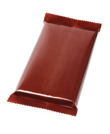 Chocolate Bar In Plastic Wrapping on White Background photo