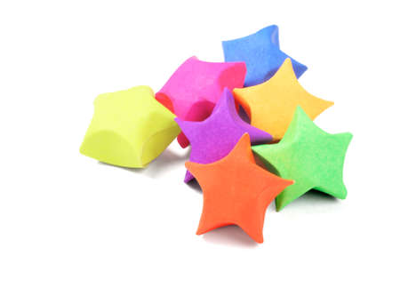 paper folding: Colorful Origami Paper Stars On White Background Stock Photo
