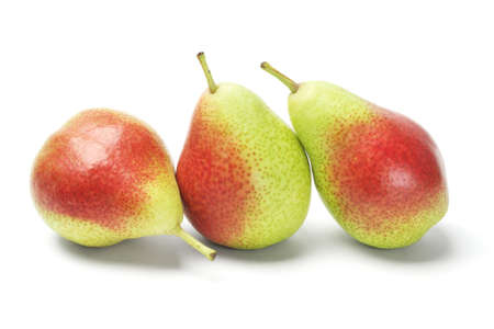 bell shaped: Three Blush Pears In A Row On White Background Stock Photo
